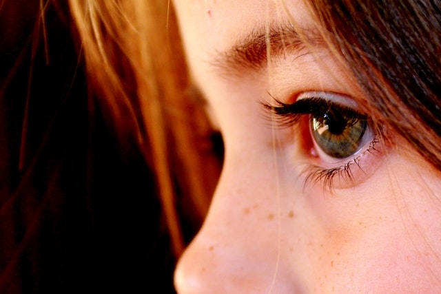 Up-close of a child's eye and partial face